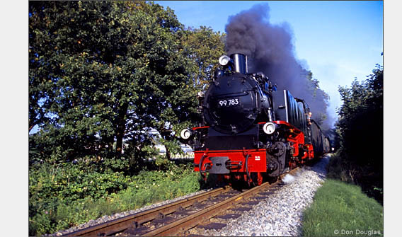 The narrow-gauge railroad train, Rasende Roland, travels on the island of Ruegen.
